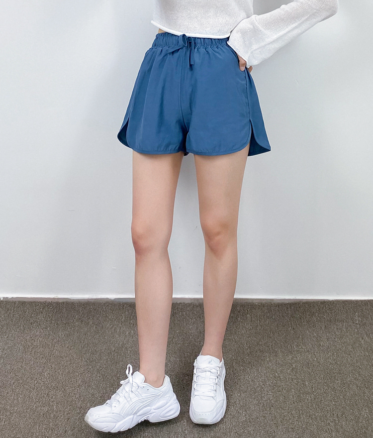 QUIETLABDolphin Hem Drawstring Waist Mini Shorts